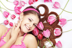 Beautiful girl with tulips Stock Image