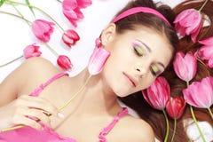 Beautiful girl with tulips Stock Photos