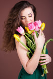 Beautiful girl with tulips Stock Images