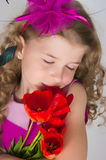 Beautiful girl and tulips Royalty Free Stock Photography