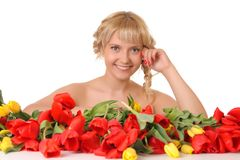 Beautiful girl in the tulips Stock Photography