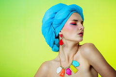 Beautiful girl in a turban in beautiful earrings and necklace Royalty Free Stock Image