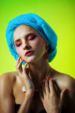 Beautiful girl in a turban in beautiful earrings and necklace Stock Images