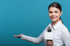 Beautiful girl TV journalist with pretty smile is Royalty Free Stock Photography