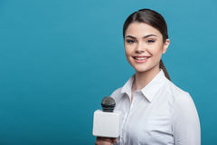 Beautiful girl TV journalist with pretty smile is Stock Image