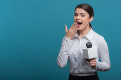 Beautiful girl TV journalist is reporting and Stock Images