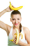 Beautiful girl with two bananas. Studio shot royalty free stock images