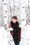 Beautiful girl about two birches Stock Image