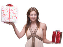 Beautiful girl with two gifts Royalty Free Stock Photography