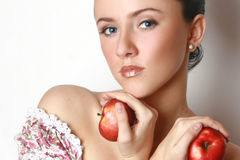 Beautiful girl with two red apples Stock Photos