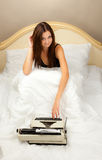 Beautiful girl with a typewriter. Stock Photos