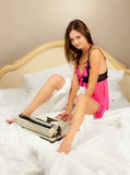 Beautiful girl with a typewriter. Stock Image