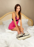 Beautiful girl with a typewriter. Royalty Free Stock Images