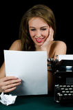 The beautiful girl at a typewriter. A retro style Stock Image