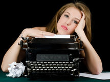 The beautiful girl at a typewriter. A retro style Royalty Free Stock Photography