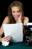 The beautiful girl at a typewriter. A retro style Stock Photos