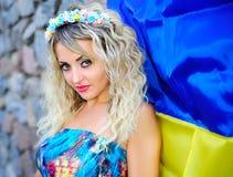 Beautiful girl and Ukrainian flag Stock Image