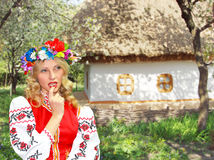 Beautiful girl in the Ukrainian national costume in garden Stock Image