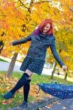 Beautiful girl with umbrella in autumn scene Stock Image