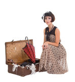 Beautiful  girl with umbrella and old suitcase Royalty Free Stock Images