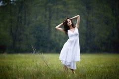 Beautiful girl under rain Stock Image