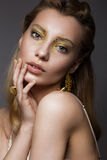 Beautiful girl in Underwear with creative gold makeup and hair. The beauty of the face. Royalty Free Stock Photos