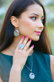 Beautiful girl with a unique silver jewelry posing in a spring g Stock Images