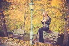 Beautiful girl use phone Stock Images
