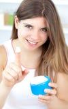 Beautiful girl using cream Royalty Free Stock Photo