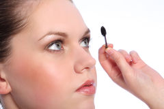 Beautiful girl using eye lash separator brush Royalty Free Stock Photography
