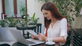Beautiful Girl Using an iPad in the Room Royalty Free Stock Photos