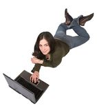 Beautiful girl using a laptop on the floor Stock Photos