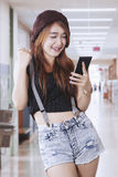 Beautiful girl using a mobile phone Royalty Free Stock Photo