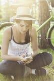 Beautiful girl using smart phone in park Royalty Free Stock Image