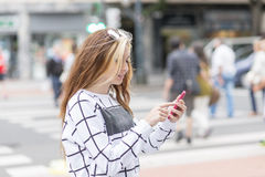 Beautiful girl using smart phone in the street, modern lifestyle Stock Photos