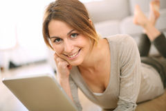 Beautiful girl using tablet at home Stock Photography