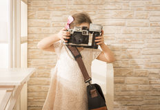 Beautiful girl using vintage photo camera Stock Photo