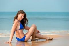 Beautiful girl on vacation near the sea Stock Photos