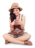 Beautiful girl on vacation and playing mobile phone Royalty Free Stock Photo