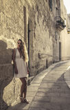Beautiful girl on vacation wearing a white dress Royalty Free Stock Photo