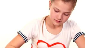 Beautiful girl in varicolored shirt paints color a stock video