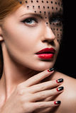 Beautiful girl with a veil, evening makeup, black Stock Photos