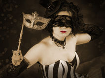 Beautiful girl with a venetian mask. Royalty Free Stock Photos