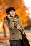 Beautiful girl. Vertical photo, stylish beautiful little girl hold mobile phone and gladness talk royalty free stock photo