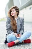 Beautiful girl with very long hair. To drink coffee. Concept of lifestyle, urban, leisure, students.  royalty free stock photo