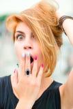 Beautiful girl very surprised face Stock Image