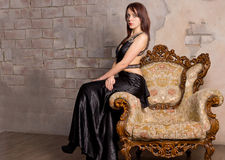 Beautiful girl on a vintage armchair Royalty Free Stock Photos