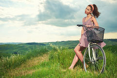 Beautiful girl with vintage bike outdoor, Tuscany summer time Royalty Free Stock Photos