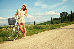 Beautiful girl with vintage bike outdoor, Tuscany summer time Stock Images