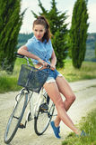 Beautiful girl with vintage bike outdoor, Tuscany summer time Royalty Free Stock Image